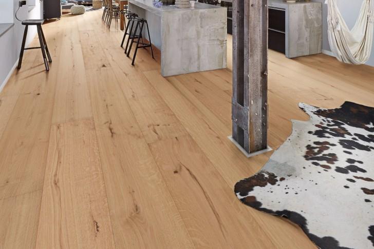 So schützen Sie Holzböden mit Teppichen