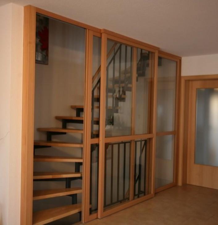 gleittürenelement vor treppenhaus,buche und klarglas | keller renovierung